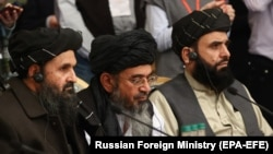 Mullah Abdul Ghani Baradar (center), the Taliban's deputy leader and chief negotiator, attends an international peace conference in Moscow on March 18 with members of a Taliban delegation.