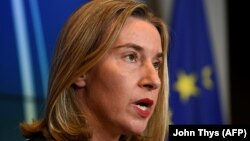EU foreign-policy chief Federica Mogherini said she would visit Washington early next month to urge U.S. lawmakers not to pull out of the Iran deal.