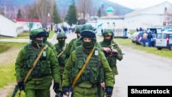 """Little green men"" -- Russian military forces in Crimea in March 2014."