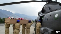 Pakistani soldiers load the coffin of the Norwegian ambassador into an army helicopter.