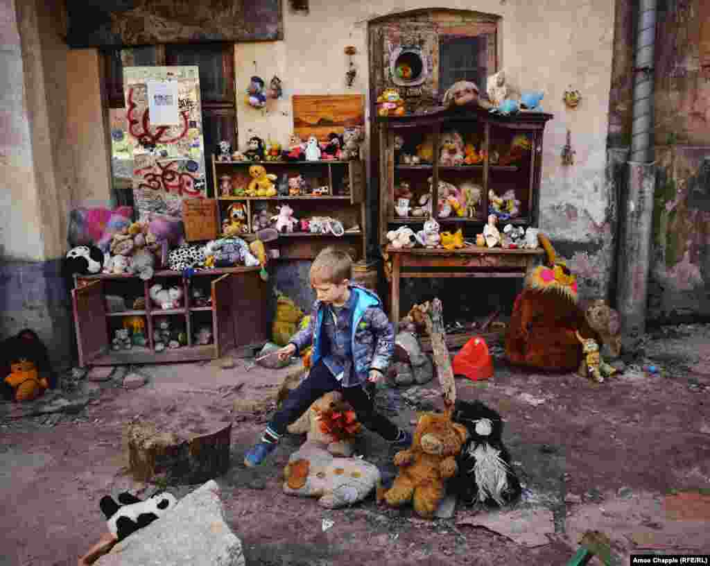 A yard full of lost toys in Lviv, Ukraine, on April 4. This typical urban courtyard in one of Lviv's oldest neighborhoods has become a makeshift museum, and home to an unlikely exhibition of toys. Find out more about the 'Toy Orphanage' Of Ukraine. (Amos Chapple, RFE/RL)