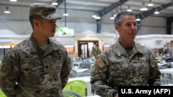 U.S. Army Lieutenant General Scott Miller (right) with one of his soldiers