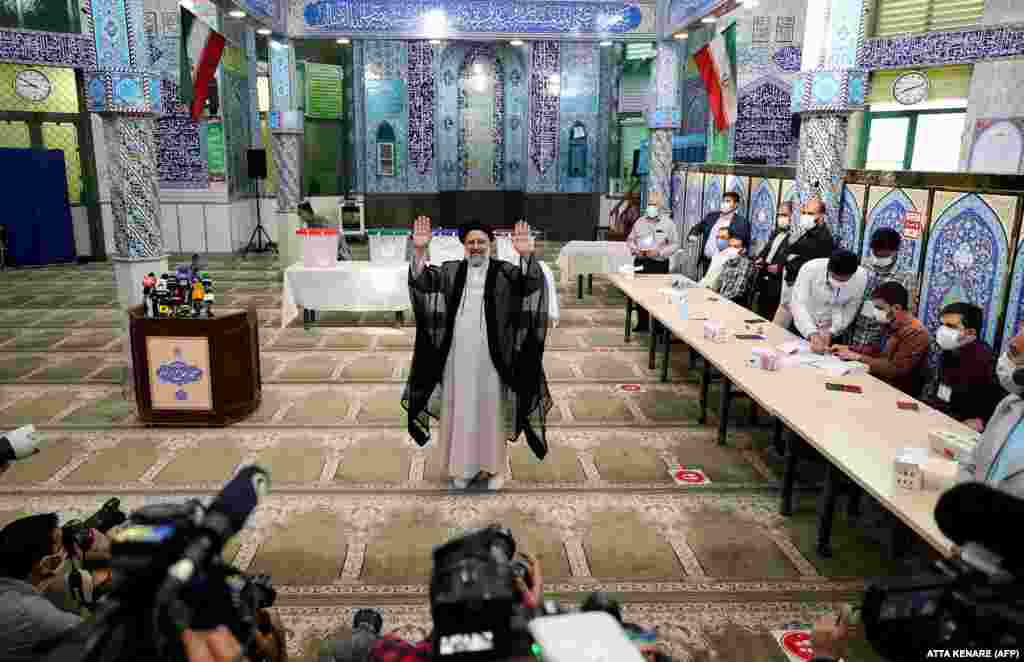 Raisi after casting his ballot in Tehran. The 60-year-old chief justice is widely expected to replace President Hassan Rohani, who is ineligible to run after serving two consecutive terms.