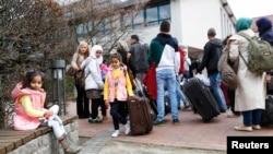 Сирийские беженцы в германском городе Фридланд