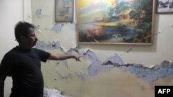 Поврежденное в результате землетрясения здание. Индия, 19 сентября 2011 года.
