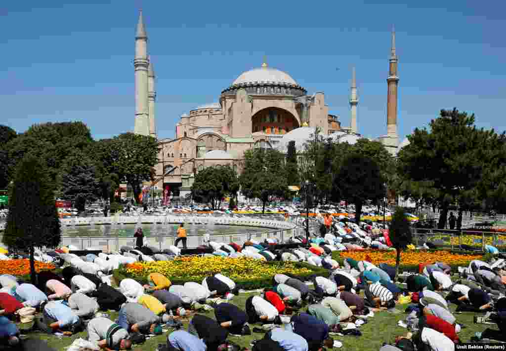 Hundreds of Muslims pray outside Hagia Sophia on July 24. Some reportedly spent the night outside waiting for the historic reopening.