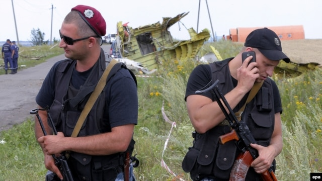 Ukraine -- Pro-Russian armed rebels guard the debris at the main crash site of the Boeing 777 Malaysia Airlines flight MH17, which crashed during flying over the eastern Ukraine region, near Hrabovo, 20 July 2014