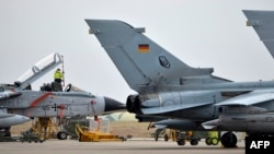 A technician works on a German Tornado jet at the air base in Incirlik in January.