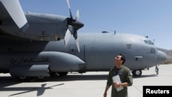 An Afghan Air Force pilot checks a C-130 military transport plane. (file photo)
