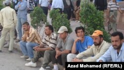 A group of unemployed men in Sulaymaniyah, Iraq, in June 2011