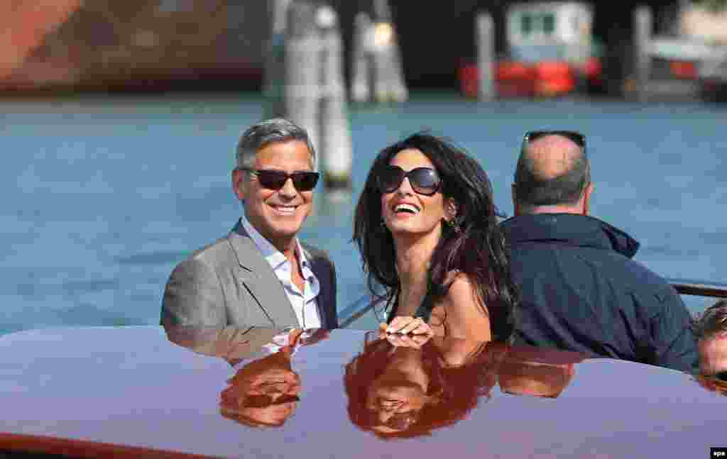 U.S. actor George Clooney and his fiancee, Lebanese-British lawyer Amal Alamuddin, arrive in Venice on September 26. According to media reports, the two are scheduled to get married in Venice at the weekend. (epa/Alessandro Di Meo)