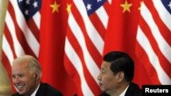 Xi Jinping meets with his U.S. counterpart, Joe Biden, in Beijing in August 2011.