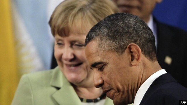 "Numbers 1 and 2 on the ""Forbes"" list, U.S. President Barack Obama and German Chancellor Angela Merkel"
