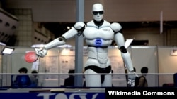 Japan -- TOPIO, a humanoid robot, played ping pong at Tokyo International Robot Exhibition (IREX) 2009