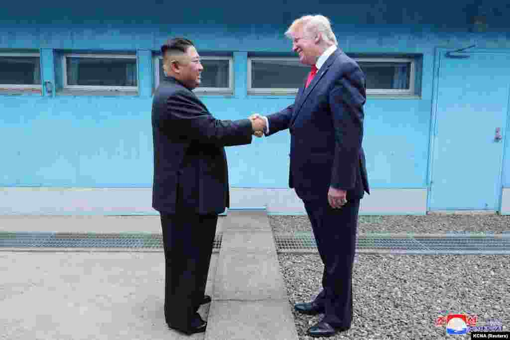 U.S. President Donald Trump (right) shakes hands with North Korean leader Kim Jong Un as they meet at the Demilitarized Zone separating the two Koreas in Panmunjom, South Korea, on June 30. (Reuters)
