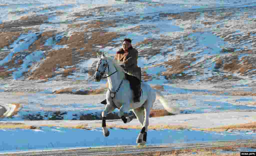 North Korean leader Kim Jong Un rides a white horse amid the first snow on Mount Paektu near the Chinese border. (AFP)