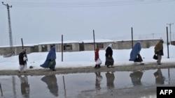 Afghans walking along a street in Kabul.