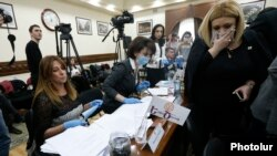 Armenia - Zaruhi Postanjian (L) and two other members of her Yekir Tsirani party stage a protest at a session of Yerevan's municipal council, 13 February 2018.