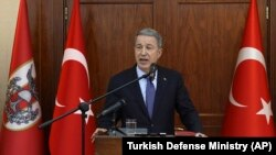 TURKEY -- Turkish Defense Minister Hulusi Akar speaks to a group of reporters in Ankara, May 21, 2019