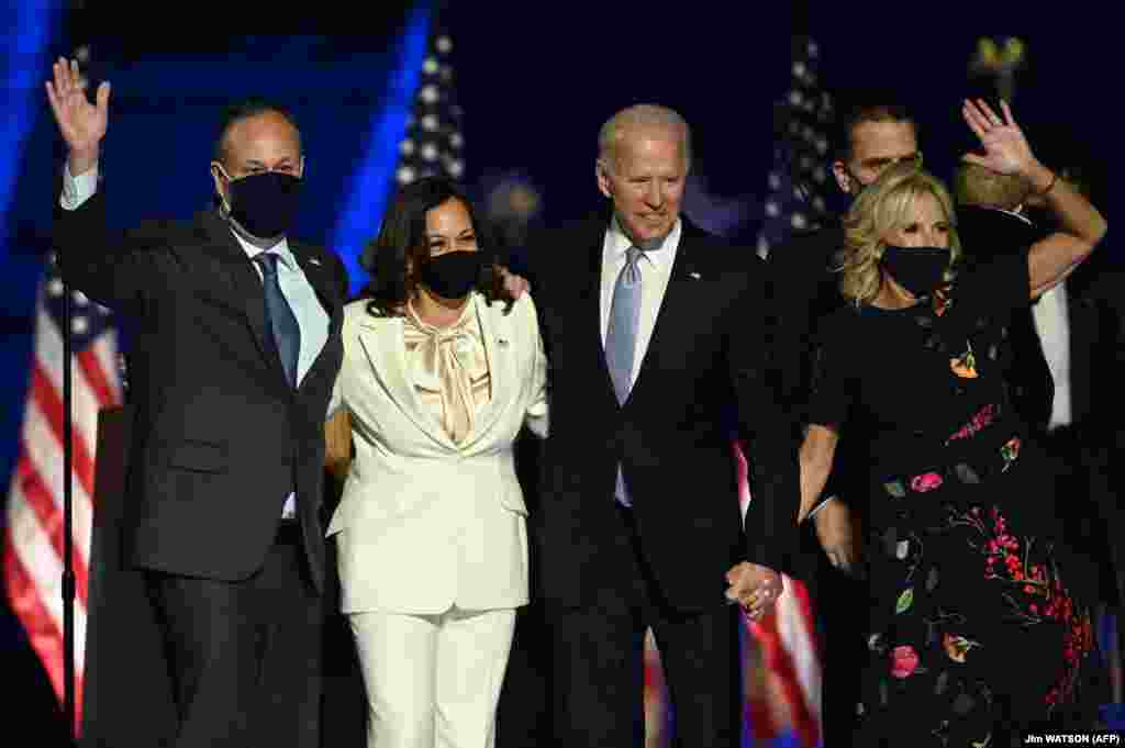 U.S. President-elect Joe Biden and Vice President-elect Kamala Harris stand with spouses Jill Biden and Doug Emhoff after delivering remarks in Wilmington, Delaware, on November 7, 2020, after being declared the winners of the presidential election.