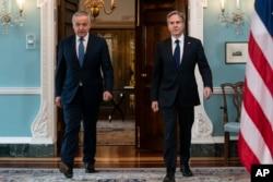 Blinken and Tajik Foreign Minister Sirojiddin Muhriddin (left) arrive at the State Department on July 1.