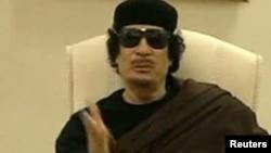 Muammar Qaddafi appeared on TV speaking at a Tripoli hotel on May 11.