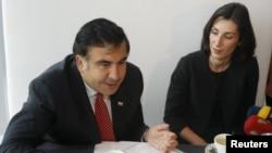 Президент Грузии Михаил Саакашвили и новый министр внутренних дел Эка Згуладзе