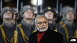 FILE: Indian Prime Minister Narendra Modi reviews an honor guard during a welcoming ceremony at Moscow's Vnukovo airport outside Moscow in December 2015