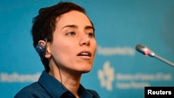 Iranian mathematician Maryam Mirzakhani speaks at an awards ceremony for mathematicians in Seoul in 2014.