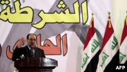 Iraqi Prime Minister Nuri al-Maliki gives a speech to a police unit in Baghdad on January 9.