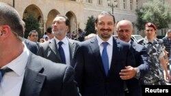 Saad al-Hariri i shoqëruar nga truprojat e tij