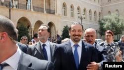سعد الحريري مع أمنه الخاص في بيروت، آب 2014.