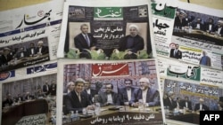 Iranian newspapers feature Iranian President Hassan Rohani and U.S. President Barack Obama, as well as Iranian Foreign Minister Mohammad Javad Zarif meeting his U.S. counterpart John Kerry on September 28.