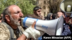 ARMENIA -- Opposition leader Nikol Pashinian (R) speaks in a megaphone as he takes part in an opposition rally in central Yerevan, April 17, 2018