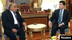 Iraqi Oil Minister Adil Abd al-Mahdi (left) meets with Iraqi Kurdistan's Prime Minister Nechirvan Barzani in Irbil, north of Baghdad, on November 13.