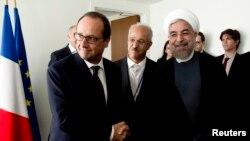 دیدار فرانسوا اولاند، رییس جمهوری فرانسه با حسن روحانی در حاشیه نشست مجمع عمومی سازمان ملل در سال ۱۳۹۳.