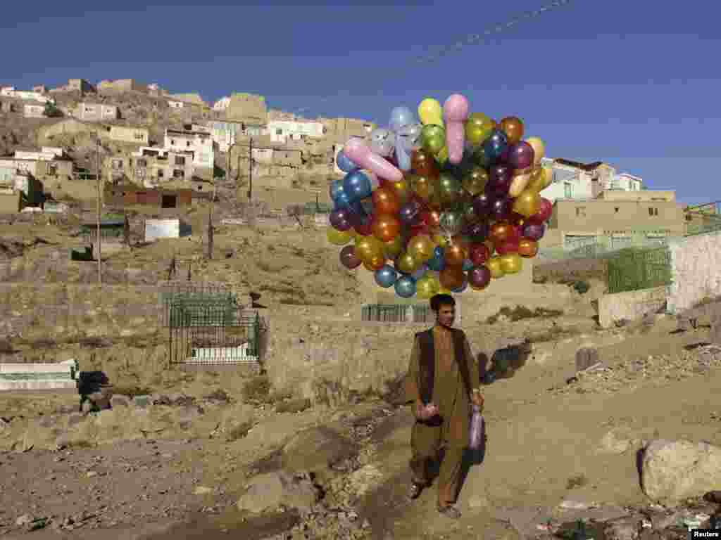 An Afghan man holds balloons for sale in Kabul. (Mohammad Ismail for Reuters)