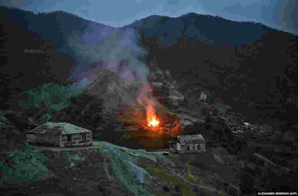 A house burns into the night in the district of Karvachar/Kalbacar.