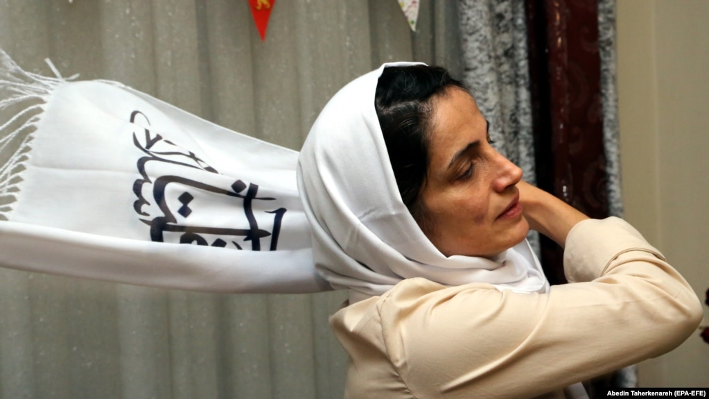 Imprisoned Iranian lawyer and human rights activist Nasrin Sotoudeh adjusts her scarf at her house in Tehran, September 18, 2013