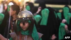 Iraqi Shi'a perform a reenactment of the Battle of Karbala in Baghdad as part of a parade in preparation for Ashura.