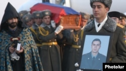 Armenia - The funeral of Lieutenant Gurgen Markarian, an Armenian army officer who was axe-murdered by an Azerbaijani colleague during a NATO training course in Budapest, 25Feb2004.