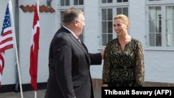 U.S. Secretary of State Mike Pompeo is greeted by Danish Prime Minister Mette Frederiksen in Copenhagen on July 22.