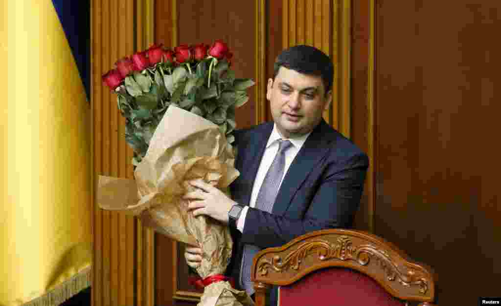 "Newly appointed Ukrainian Prime Minister Volodymyr Hroysman holds a bouquet of roses in parliament in Kyiv on April 14. ""I will show you what leading a country really means,"" Hroysman said ahead of the vote, which also finalized the resignation of Prime Minister Arseniy Yatsenyuk. (Reuters/Valentyn Ogirenko)"