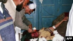 A Pakistani paramedic gives treatment to an injured suicide blast victim at a hospital in Lakki Marwat today.