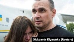 Ukrainian film directorOlehSentsov hugs his daughter Alina Sentsova upon arrival in Kyiv after the Russia-Ukraine prisoner swap on September 7.