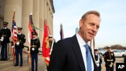 FILE - In this Wednesday, Dec. 19, 2018 file photo, Deputy Defense Secretary Patrick Shanahan, speaks to reporters on the steps of the River entrance of the Pentagon. President Donald Trump says Defense Secretary Jim Mattis will leave his post on Jan. 1.
