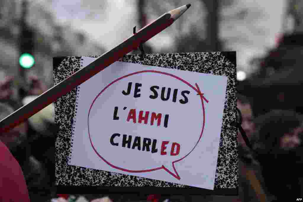 "The sign reads ""Je suis l'ahmi Charled,"" a play on words on the slogan ""Je suis Charlie"" and refers to Ahmed Merabet, a French police officer killed in the attack."