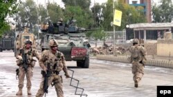 Canadian soldiers with NATO's International Security Assistance Force (ISAF) secure the site of multiple suicide bomb attacks outside the provincial council office in Kandahar in April 2009.