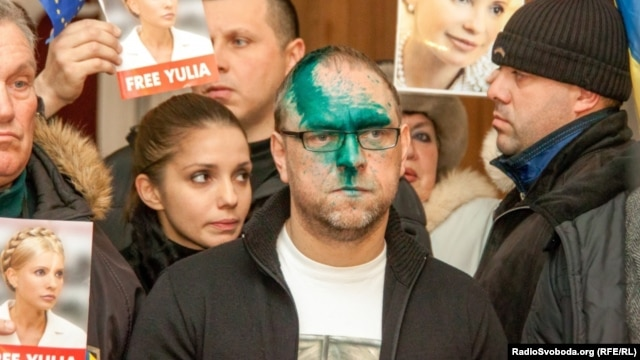 Serhiy Vlasenko faces the press after the attack.