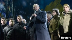 Arseniy Yatsenyuk addresses antigovernment protesters during a rally in Kyiv on February 18.